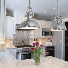Contemporary Kitchen by Silver Leaf Construction & Renovation
