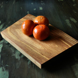 Natural Edge Serving Boards - 60nobscot's Serving Boards from shop scraps & cut-offs are chosen for the character of their grain, figure, shape and color making them perfect for serving Sushi, Cheese, Bread or any other use that demands an striking presentation. They are all on felt covered feet to allow them to be scratch free on other fine surfaces.