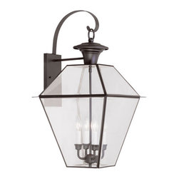 Livex Lighting - Livex Lighting 2386 Westover Large Outdoor Wall Sconce - Livex Lighting 2386 Westover Four Light Outdoor Wall SconceA classic shape that has withstood the test of time, the Westover four light outdoor wall sconce features a top mounted design based off the popular lantern motif mounted with a decorative curled arm and surrounded by large clear beveled glass panes that allow this handsome light to give out plenty of light in all directions. The Westover is the perfect addition to light up your garage, entry, patio, or other outdoor area.Livex Lighting 2386 Features: