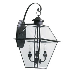 Quorum Lighting - Quorum Lighting Duvall Transitional Outdoor Wall Sconce X-63-4-927 - From the Duvall Collection comes this clean yet traditional styled Quorum Lighting outdoor wall sconce. The traditional design features clean lines that highlighted by the dark tones of the Bronze finish. Clear glass panels and candelabra style lights pull the look together.