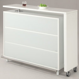 Chintaly Imports - Barclay All White Extendable Bar in Gloss White - Unique modern L board bar. Extendable and convertible. Plenty of storage. Plenty of bar counter area. Features 6 shelves and a cabinet with a door. L board on casters for ease. Clean crisp white finish.