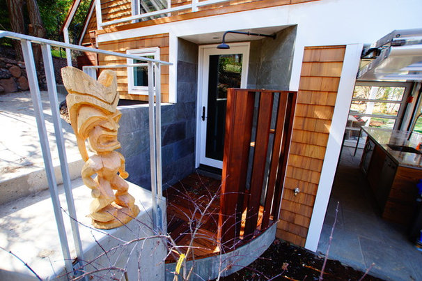 Eclectic Exterior by Cairn Construction Inc.