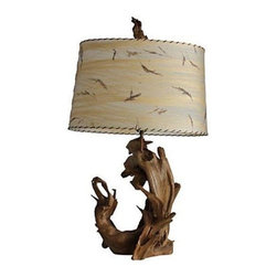 "Pre-owned Vintage 50's Driftwood Lamp - A large 1950's driftwood sculptural table lamp with the original fiberglass shade and driftwood finial.  Keep as is or add a sleek black shade for a more modern take.  Original wiring in working condition.  Shade measures 22.5""L x 13""W x 13.75""H."