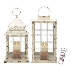 "Asian Import + USA - Antique White Lantern Set with Flameless Color Candles - If you adore antiques, these cottage style lanterns are perfect to offer your home or event an earthy appeal with a vintage look. Classy and charming, these lanterns make ideal ""chic decorator accents or table centerpieces. They remind me of what Martha Whatshername would have chosen! Overall dimensions are approximately 10""W x 5""D x 22""H."