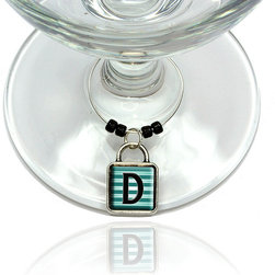 """Made on Terra - Letter D Initial Black Teal Stripes Wine Glass Silver Charm - Your guests have arrived and the atmosphere is electric. A sip of wine here, a sip of a cocktail there and you find the conversation turning to the charming baubles you've placed on the glasses, something special you chose for each of your eclectic guests. They love them and appreciate your thoughtfulness. You love them for their uniqueness and that no one forgets which glass they were using.  Choose from Made on Terra's many designs for the best party ever. Ring is 1"""" diameter; measures 2"""" from top of ring to bottom of charm. Made of metal and plastic. Sold individually."""