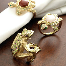 Gold-Plated Turtle/Frog Napkin Rings - For those who are looking for an excuse to seriously splurge and add bling to every corner of the home, these gold-plated turtle and frog napkin rings are just right. And who wouldn't love to have gold, pearls and semi-precious stones adorning their tables? I just love those cute turtles.