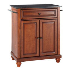 Crosley - Cambridge Solid Black Granite Top Portable Kitchen Island in Classic Cherry - Constructed of solid hardwood and wood veneers, this kitchen island is designed for longevity. The beautiful raised panel doors and drawer front provide the ultimate in style to dress up your kitchen. The deep drawer are great for anything from utensils to storage containers. Behind the two doors, you will find an adjustable shelf and an abundance of storage space for things that you prefer to be out of sight. Style, function, and quality make this kitchen island a wise addition to your home.