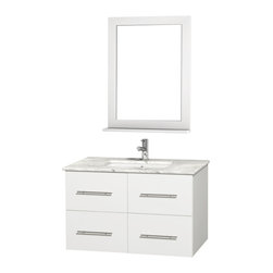 Wyndham Collection - 36 in. Vanity Set in White Finish - Includes matching mirror with shelf. Faucets not included. Two functional drawer. Two functional door. Plenty of counter and storage space. Brushed chrome exterior hardware finish. Single faucet hole mount can be drilled for 3-hole faucets on site. Concealed soft-close door hinges. Fully-extending under-mount soft-close drawer slides. Deep doweled drawers. Unique and striking contemporary design. Highly water-resistant low V.O.C. sealed finish. 12-stage wood preparation, sanding, painting and finishing process. Lifetime warping prevention. Square porcelain undermount sink. White Carrera top. Made from solid oak wood. Vanity: 36 in. W x 21.5 in. D x 22.75 in. H. Mirror: 24 in. W x 5 in. D x 32 in. H. Handling Instructions. Assembly Instructions - Vanity. Assembly Instructions - Countertop. Assembly Instructions - Sink. Assembly Instructions - MirrorSimplicity and elegance combine in the perfect lines of the Centra vanity by the (No Suggestions) collection. If cutting-edge contemporary design is your style then the Centra vanity is for you - modern, chic and built to last a lifetime. Available with green glass, pure white man-made stone, ivory marble or white Carrera marble counters, and featuring soft close door hinges and drawer glides, you'll never hear a noisy door again! Meticulously finished with brushed chrome hardware, the attention to detail on this beautiful vanity is second to none.