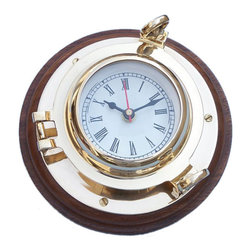 """Handcrafted Model Ships - Brass Porthole Clock 7"""" Brass Nautical Clock Decorative Wall Clocks Beach Living - A classy and quality accent to any nautical themed room, the Hampton Nautical brass porthole clock is made of polished solid brass on a dark-stained solid rosewood base. Featuring Roman numerals with 15-minute intervals. With a functional hinge and two twist screws, this porthole clock opens to reveal the mechanism and to enable you to change the time or batteries."""