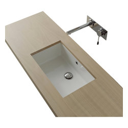 Scarabeo - Rectangular White Ceramic Undermount Sink - Designed to fit under the hand crafted vanity top, this white ceramic sink is simple, elegant and made to last. Reflecting the best practices and materials, this sink is made by Italian craftsmen who value your desire for elegant looks, lasting performance and environmental respect. Free of harmful pollutants, this sink will be safe for you and those who use it for years to come. Contemporary undermount rectangular white ceramic sink with overflow.  Beautiful undermounted wash basin for the bathroom with no hole.  Made in Italy by Scarabeo. Rectangular white ceramic sink. Ultra low emission of harmful pollutants. Made to match the vanity top. Imported from Italy. Undermount with overflow. From the Scarabeo Miky Collection. Standard drain size of 1.25 inches.