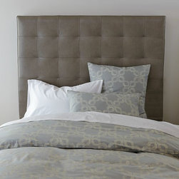 New Tall Grid-Tufted Leather Headboard - Low-key luxe. The classically handsome look of a leather-upholstered headboard gets softened by geometric tufted detailing, allowing for an aesthetic that's equal parts feminine and masculine. This tall version is a full two rows of tufting higher than the original.