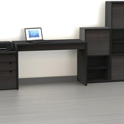 Nexera - Nexera Sereni-T Computer Desk with Filing Cabinet and Optional Bookcases - Large - Shop for Desks from Hayneedle.com! You'll get everything you need for your home office with the Nexera Sereni-T Computer Desk with Bookcase and Filing Cabinet - Large - Black - just add your own coffee and paperwork. The collection starts with a reversible easy-to-configure desk surface that's supported on one side by the filing cabinet which features one legal-size file drawer and two storage drawers. Two bookcases round out the collection - you'll get a short bookcase with four shelves and a tall one with six shelves. The cabinet doors on the bookcases can be positioned in the top middle or bottom and the filing cabinet features sturdy metal drawer glides. All pieces are made of engineered wood with a duo-tone black/ebony finish that resists scratching and stains. Dimensions: Desk: 47.75W x 19.75D x 29.5H inches Filing cabinet: 18.87W x 19.75D x 24.5H inches Short bookcase: 11.87W x 18.87D x 37.87H inches Tall bookcase: 11.87W x 18.87D x 56H inches About NexeraNexera whose name is a combination of the words next era is a Canadian manufacturer of affordable ready-to-assemble furniture known for its innovative cosmopolitan style. At their factory in Laval Canada Nexera employees utilize state-of-the-art equipment to manufacture their modern furniture collections including bedroom collections entertainment furniture office furniture and utility furniture. From start to finish Nexera upholds high standards of care for the environment when making their furniture. All raw material (particle board) originates from FSC (Forest Stewardship Council) certified forests only and energy used comes from renewable sources only such as hydro-electricity and windmill power. Nexera meets the CARB (California Air Resources Board) requirements for clean air and it recycles over 92% of its factory waste. Nexera products are packaged with 100% recycled fibers. Because of the materials they are constructed with Nexera products are also able to be recycled at the end of their life cycle which reduces landfill waste.