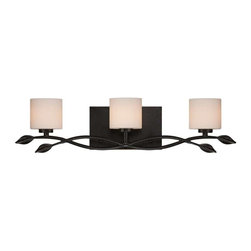 Quoizel - Quoizel 3-Light Erin Bath Fixture in Imperial Bronze - ERN8603IB - The relaxed styling of this piece has a bit of whimsy with its swirled vine and leaf motif. The wrought iron and opal etched glass add to the overall feel of its hip, coffeehouse style.