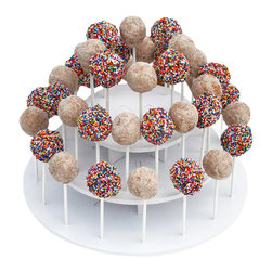 The Smart Baker - The Smart Baker 3-Tier Round Cake Pop Stand - No more poking holes in Styrofoam or cardboard, our chic white PVC Cake Pop Stand has spaces that fit your cake pop sticks perfectly and holds them snugly in place.  The PVC wipes down easily, so it is re-usable for event after event.  These cake pop displays have three tiers that hold up to 40 cake pops or lollipops.  Not making 40 cake pops? Simply remove a tier and customize it to your needs.  Just like our Cupcake and Treat Towers, they are size adjustable and can be used in different tier configurations.  Tier widths are staggered so that pops on the tier below and stand outside of the tier above it.