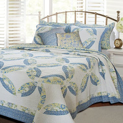Greenland Home Fashions - Greenland Home Fashions Francesca Bonus Quilt Set - GL-1107ABST - Shop for Bedding Sets from Hayneedle.com! If you're not a quilting aficionado then you need to know that the interlocking ring pattern on the Greenland Home Fashions Francesca Bonus Quilt Set is actually called a wedding ring and it's a traditional quilting pattern. You'll want to sound like a pro because people will believe you really know your stuff when you outfit your bed with this complete set. Sporting a classic design the quilt is made with a high-quality 100% cotton face stitching and fill. The quilt's reverse side has a coordinating all-over paisley pattern that allows you to choose between two distinctly different looks. Machine-quilting adds durability while the oversized shape gives the greater coverage you need for today's deeper mattresses. Along with the quilt you'll receive a pair of coordinating decorative pillows and one or two shams depending on the size you order. Each piece is pre-washed pre-shrunk and machine-washable.Product Dimensions:Twin comforter: 88L x 68W in. Full/queen comforter: 90L x 90W in.King comforter: 95L x 105W in.Small sham: 20L x 26W in.Large sham: 20L x 36W in.Decorative pillow: 16W x 16L in.About Greenland Home FashionsFor the past 16 years Greenland Home Fashions has been perfecting its own approach to textile fashions. Through constant developments and updates - in traditional country and more modern styles the company has become a leading supplier and designer of decorative bedding to retailers nationwide. If you're looking for high-quality bedding that not only looks great but is crafted to last consider Greenland.