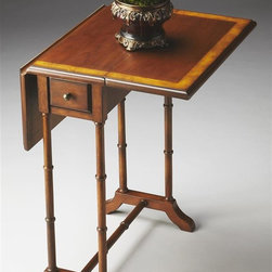 Butler - Masterpiece Drop-Leaf End Table - Traditional style. Cherry veneer top with drop leaves. Sleek bamboo style legs. Drawer opens with antique brass pull. Made from wood. Olive ash burl finish. Minimum: 9.75 in. L x 20 in. W x 26 in. H (17 lbs.). Maximum: 24 in. L x 20 in. W x 26 in. H (17 lbs.)Stretcher provide an Asian flair to this drop-leaf table. Masterpiece represents Butler's hand-picked collection of lifestyle pieces for those with discriminating tastes and a desire to be different. This collection is, above all, eclectic, offering a wide range of styles designed to provide bright accents for traditional to contemporary decors.