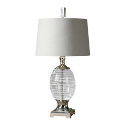 Uttermost Pateros Swirl Glass Lamp - Clear glass with white swirls with polished nickel plated metal details. The clear glass base is accented with white swirls and polished nickel-plated metal details. The round, tapered hardback shade is off-white linen fabric with natural slubbing and a silver hardback liner.