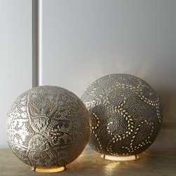 Four Hands Marrakech Round Lamp - These unique lamps give any home whimsical interest and can be incorporated in numerous ways. I would love to see them on a covered patio mingling with conversation, or even quietly in the corner giving off a romantic glow.