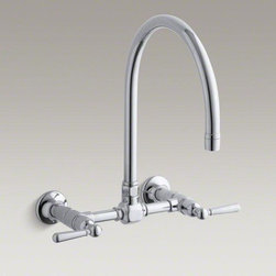 KOHLER Polished Stainless Hirise Two-hole Wall-mount Bridge Kitchen Sink Faucet - HiRise faucets combine the concepts of vintage plumbing with the strength and beauty of stainless steel to create truly sophisticated designs. This wall-mount faucet reintroduces a classic design that suits urban lofts as well as traditional kitchens. The high clearance of this gooseneck swing spout allows you to easily fit large dishes underneath for cleaning, and the wall-mount design saves space and keeps the counter clear for prep tasks. This faucet is outfitted with easy-to-install and leak-free UltraGlide valves for excellent performance.