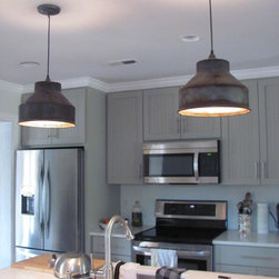 Pendant Lighting - These Milk Can Strainer Pendant Lights were purchased by a couple who sent us a photo and a note to tell us how much they love them.