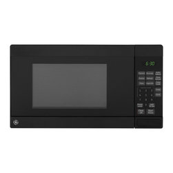 GE - GE Black 0.7-cubic Foot Countertop Microwave Oven - This microwave from GE showcases a bold black color that matches any other kitchen decor. Features include one-touch cooking controls,auto and time defrost,instant on controls,control lockout,kitchen timer and cooking complete reminder.