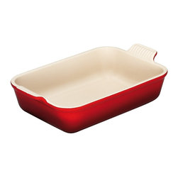 Le Creuset - Le Creuset Heritage Stoneware  10-by-7-inch Baking Dish - Le Creuset stoneware dishes are versatile, multipurpose designs that offer all the even-heating benefits of stoneware in a variety of shapes and capacities to fit nearly any baking, roasting or broiling recipe. Each dish features grooved handles for a sure grip, plus Le Creusets glazed interior that protects against utensil damage, staining and odor absorption, making each dependable piece of stoneware easy to use and easy to count on.
