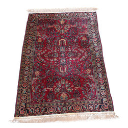 3'6 x 4'10 Antique Sarouk Rug - A Sarouk Rug is a type of Persian Rug from province of Arak in Iran.  Sarouk rugs have been produced for much of the last century. The early successes of the Sarouk rug are largely owed to the American market. From the 1910s to 1950s, the �American Sarouk� also known as the �Painted Sarouk� was produced. American customers had an affinity for the Sarouk�s curvilinear and floral designs. What they did not appreciate, however, was the color, so for much of the 1920s, 30s and 40s, rugs exported from Iran would get a dye job to a desirable, deep, raspberry-red color, once they made it to the States.