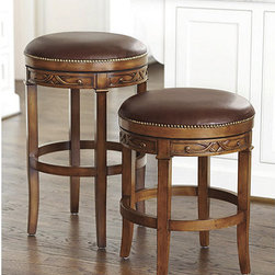 Ballard Designs - Belleville Swivel Barstool - Solid hardwood frame. Backless design slips neatly beneath counter. Seat swivesl 360 degrees for easy conversation. Hand carved scrollwork around the skirt raises our Belleville Stool to the next level of sophistication. Substantial, solid hardwood frame is artisan crafted with generous, deeply padded seat hand covered in rich, supple leather trimmed in antique brass finish nail heads.Belleville Swivel Barstool features: . . .