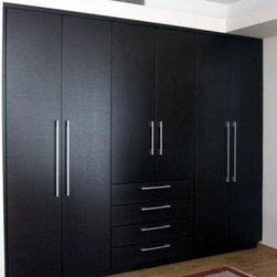 Built-in Closets - This is an amazing wardrobe design great for complimenting  your interior decoration. Dayoris designs, builds, and installs  pieces like. We rejuvenate your closet space in no time. Choose as many drawers, compartments, and shelves as you like. Our distinctive high-end product will inspire the creativity and authenticity your modern home longs for. Crafted to last, our contemporary furniture is made with the finest material imported from Italy. We also carry modern door hardware to exactly match your doors and drawers.