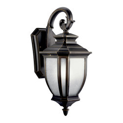 Kichler 1-Light Outdoor Fixture - Rubbed Bronze Exterior - One Light Outdoor Fixture With an unmistakable British influence this elegant 1 light energy efficient wall lantern displays enduringly good-taste for exterior applications. Rubbed bronze finish and white-linen glass style and refinement for your home. 1-light, 2700k pls 18-w. Lamps included. . Width 8, height 19, extension 11. Height from center of wall opening 3-1/2. Backplate size: 5-3/4 x 9-1/2. U. L. Listed for wet location