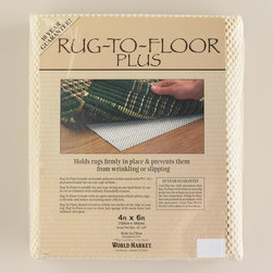 World Market - Rug Pad - Hold any kind of rug firmly in place and prevent wrinkling and slipping with our durable, polypropylene vinyl Rug Pad. It provides greater gripping power and is slip-resistant, plus it's guaranteed to be stain-free on any type of floor. The open construction allows rugs to breathe.