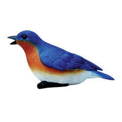 Michael Car Designs - Michael Carr Natural Blue Bird Chirper Resin Statue - MCD80033 - Shop for Statues and Sculptures from Hayneedle.com! Fill your garden with the sound of natural wildlife with the Michael Carr Natural Blue Bird Chirper Resin Statue. Part of the Forest Critters collection from Michael Carr Designs this cute and lifelike creature adds personality and charm to any yard or garden. Chirps with the sounds of actual birds when motion sensor is activated. The sound the Blue Bird chirper makes is that of an actual blue bird. The chirper is activated by a motion sensor and includes an on/off switch. The chirper is powered by 3 AA batteries (included) and each chirp lasts approximately 15 seconds. This handsome critter is hand-made from durable high-quality polyresin material and then hand-painted for quality. The durable polyresin has a U.V. coating that resists cracking or chipping from the sun.About Michael Carr DesignsDesigning an exclusive line of high-end garden pottery fountains statuaries and bird baths Michael Carr Designs brings something new and innovative to your outdoor living space. There's something for everyone with their fashionable colors soft raining finishes and multiple styles. Each piece is hand-made beginning with a craftsman molding the clay and ending with a rustic Old World kiln. This means each piece is unique a true one-of-a-kind. Michael Carr Designs works in a variety of materials like Vietnamese glazed pottery Malaysian pottery Italian terracotta pottery and resin just to name a few.