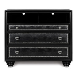 Magnussen - Magnussen Furniture Onyx Drawer Media Chest in Black - What better way to enjoy classic cinema than from this stunningly detailed, fashion-forward media chest? Made from solid hardwood with a painted black finish and chrome nail heads and custom hardware, this Onyx 3-Drawer Medica Chest is as stylish as it is functional. Three drawers, two deep and one shallow, provide storage area for clothing, media and personal belongings. All drawers feature polyvinyl upholstered panel fronts that have been embossed in a crocodile skin pattern, adding stylistic artifice to a contemporary case for an all-out, stage-worthy look. Meanwhile, an open component storage area at the case top features a recessed divider and wire access holes for convenient, sightly wire management.