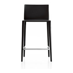 "Arper - Norma Height Stool - Features: -Stylish slim-line profile with steel inner frame, polyurethane padding and upholstered legs. -Upholstered in durable Italian hide leather to selected house color with classic expressed stitch detail. -Legs fully upholstered in hide with brushed stainless steel footrest. -Non-stacking. -Clean with damp soft cloth rinsed in soapy lukewarm water. -Wipe with dry soft cloth. -Avoid abrasive cleaners or scourers. -Hide leather can be cleaned with proprietary leather cleaners in-line with manufacturer's instructions. -Green guard certified. -5 year structural warranty. -Made in Italy. -Counter seat height 25.25"" high, overall back 34.25"" high. -Bar seat height 30.375"" high, overall back 39.375"" high."