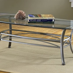 Hillsdale - Abbington Rectangular Wrought Iron Coffee Tab - A rectangular coffee table with a glass top will provide a stylish focus in any living room grouping. Wrought iron base is understated in design and features the complementary hues of pewter. Create an ensemble with matching console and accent tables. * For residential use. 8 mm. Thick rectangular glass table top. Beautiful scrollwork. Part of the Abbington ensemble. Muted Pewter finish. Some assembly required. 48 in. W x 26 in. D x 18 in. H (50 lbs.)Hillsdale's subtly sophisticated Abbington occasional collection is created by a combination of a Muted Pewter finish, elegant scrollwork, and gracefully curved legs. Complete with a glass topped end table, console table and coffee table, you can accent your entire living room, den or foyer with this lovely ensemble. Though the Abbington occasional is fabulous as a collection each individual piece is strong enough to stand alone.