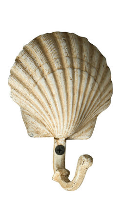 Cast Iron Seashell Wall Hook - Scallop - Keep towels at hand in the bath or kitchen, or provide a convenient coat hook that also contributes to the coordinated beauty of your entryway, with the Seashell Wall Hook. Formed into a flawless scallop shell deepened and made naturalistic by an antique white finish, this pale cast iron wall hook looks ideal on a textured accent wall or in a classic beach house.