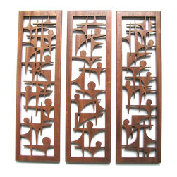 """Frederick Arndt Artworks LLC - Abstract Mid Century Modern Fretwork Grouping - This is a wonderful mid-century modern inspired fretwork grouping made out of Mahogany hardwood. Each piece measures 20"""" high x 6"""" wide x 1/2"""" thick. Each piece has a wall hanging bracket already attached. This artwork has been clear coated to ensure a long lasting quality finish. It would make a great addition to any modern home. This item is made-to-order, and as such, it is subject to lead times of 4-7 weeks."""