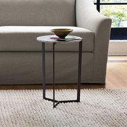Y-Base Side Table - This simple, distinctively designed table manages to find the lightness in solid white marble and raw industrial steel. Small footprint makes the table a flexible option for smaller apartments or rooms.