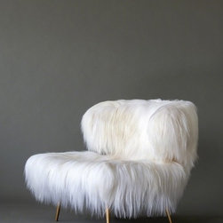 """Wooly Bella Chair - This baby is a big investment, but it caries a huge """"wow"""" effect! I once used a pair of chairs similar to this in a show house, and everyone who walked in commented on them and wanted to sit down in them. I bet this one is very warm and fuzzy and super comfy."""