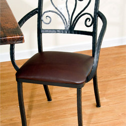 Mathews & Company - Alexander Dining Arm Chair - Combine comfort and beauty to your home or office with an Alexander arm chair. Hand wrought iron designs delicately compose the back rest of this chair. Choose between a cloth, leather, or pine seat to fit your comfort and look. Hand crafted iron arm rests drape gently down the sides of the chair and continue on to form the four legs of the chair. Choose between several iron finishes for the chair of your choice. Pictured in Leather upholstery and Black finish.