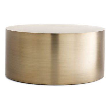 """Drum Coffee Table - """"Furniture that is too obviously designed,"""" said Milo Baughman, """"is very interesting, but too often belongs only in museums."""" While we could certainly see his Drum Coffee Table (1970s) in a museum, it would earn its place there for its simplicity and lack of unnecessary ornamentation. Distilling the idea of an occasional table to its simplest form, Baughman's cylindrical design draws you in with its smoothness and warmth. The quality construction includes edges that are welded, ground and polished by hand until there is a perfect transition from the side to the top. Leveling floor glides compensate for uneven surfaces. Made in U.S.A."""