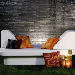La Fete Crib & Lean - This lounger looks like a movie star belongs on it. I love the contemporary shape and the fact that the material is ideal for durability in an outdoor setting.
