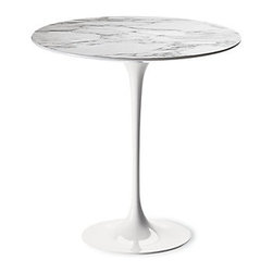 Knoll - Saarinen Side Table - Studios rarely have space for a dining room table, but that doesn't mean you don't have to have a place to dine. Choose a small bistro table and two upholstered chairs, and everyone will forget you live in a small abode.