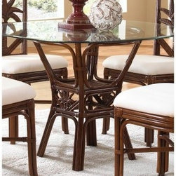 "Hospitality Rattan Cancun Palm Indoor Rattan & Wicker 42 in. Round Dining Table - Indoor rattan furniture isn't common enough these days, but the appeal of the Hospitality Rattan Cancun Palm Indoor Rattan & Wicker 42 in. Round Dining Table with Glass Top - TC Antique is going to do a lot to change that. This elegant table features an open design that is crafted from sturdy rattan poles with leather bindings. A fiber palm motif is cast in resin and finished in the same rich antique-finish shade that gives the rest of the base its elegant style. A wide sheet of tempered and beveled glass creates a tabletop that can easily accommodate four.About Hospitality Rattan Hospitality Rattan has been a leading manufacturer and distributor of contract quality rattan, wicker, and bamboo furnishings since 2000. The company's product lines have become dominant in the Casual Rattan, Wicker, and Outdoor Markets because of their quality construction, variety, and attractive design. Designed for buyers who appreciate upscale furniture with a tropical feel, Hospitality Rattan offers a range of indoor and outdoor collections featuring all-aluminum frames woven with Viro or Rehau synthetic wicker fiber that will not fade or crack when subjected to the elements. Hospitality Rattan furniture is manufactured to hospitality specifications and quality standards, which exceed the standards for residential use. Hospitality Rattan's Environmental Commitment Hospitality Rattan is continually looking for ways to limit their impact on the environment and is always trying to use the most environmentally friendly manufacturing techniques and materials possible. The company manufactures the highest quality furniture following sound and responsible environmental policies, with minimal impact on natural resources. Hospitality Rattan is also committed to achieving environmental best practices throughout its activity whenever this is practical and takes responsibility for the development and implementation of environmental best practices throughout all operations. Hospitality Rattan maintains a policy of continuous environmental improvement and therefore is a continuing work in progress. Hospitality Rattan's Environmentally Friendly Manufacturing Process All of Hospitality Rattan products are green. From its basic raw materials of rattan poles, peels, leather, bamboo, abaca, lampacanay, wood, leather strips, and boards, down to other materials like nails, staples, water-based adhesives, finishes, stains, glazes and packing materials, all have minimum impact to the environment and are safe, biodegradable, recycled, and mostly recyclable. Aside from this, the products have undergone an environmentally-friendly process that makes them """"greener."""" The company's rattan components are sourced from sustained-yield managed forests, which means the methods used to grow and harvest the rattan vines ensure the long-term life of the forest and protect the biodiversity of the forest's ecosystems. Hospitality Rattan is committed to buying and using all materials, from rattan and hardwood to finishing materials, from reputable and renewable suppliers and seeks appropriate evidence that suppliers are in compliance with this policy. Hospitality Rattan strives to use materials that are processed in an environmentally responsible manner, or consist of a high level of recycled material. Finishing materials and stains used in Hospitality Rattan's furniture products consist of 75% water-based solutions which evaporate upon application with reduced or Volatile Organic Compounds (VOCs). The furniture factories use water-based glues, stains, topcoats and other finishes on all of their products. The switch from traditional solvent-based processes to water-based processes involved consolidating several processes by the factories, resulting in an 85% reduction in VOC emissions."