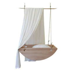 "Salt Wood Company - Bed Swing Bassinet - Rock your new baby to sleep in this hanging Bassinett. Handcrafted of cypress with an all organic finish. The bassinett hangs from 1/2 "" three strand nylon rope form two points in the ceiling. Mounting hardware included. There is a 3"" medium density fireproof foam mattress with cotton cover.  Made in our shop in Charleston SC. Salt Wood Co."