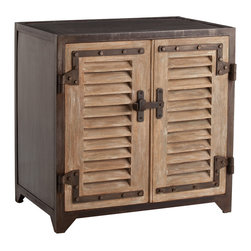 Lyon Iron/Wood Shutter Cabinet - Bring the refined rustic allure of a French maisonette to your transitional decor with a cabinet that is a rare fusion of function and beauty. The charms of the Lyon Iron/Wood Shutter Cabinet are obvious: distressed wood with a hint of aged elegance, natural iron accents, rustic hardware, shutter inspired doors. What it conceals remains your preference:  Place upon the shelves delicate linens, long held heirlooms, or private treasures you wish to preserve.