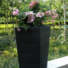 Traditional Outdoor Planters by Blue Marble Industries, Inc