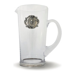 Medici Glass Pitcher - Tall, angular construction in clear glass makes the upright Medici Glass Pitcher a fine piece for presiding over a bar table or for serving water at a sociable meal, while the pewter medallion which is set into the side adds a tangible sense of times past with its regal fleur-de-lis design. Old-world family crests inspired the heraldic detail of this prized pouring vessel.