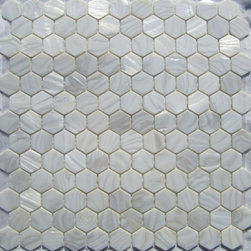 White Mother-of-Pearl 1-Inch Hexagons Tile - Mother of pearl tiles add new and unique elegance to your bathroom, backsplash, headboard, and more. Our Mother of Pearl tiles are handmade from genuine natural freshwater pearls. Although Mother of Pearl tiles are naturally thin, they are very strong and durable as well as easy to install in kitchens, bathrooms, and pools.