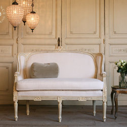 Vintage Louis French-Style Wingback Sofa by Bohemiennes - This beautiful couch has elegant lines and is perfect for so many spaces.